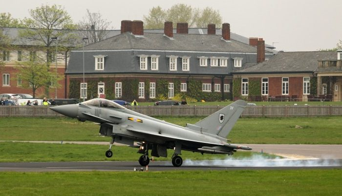 A Royal Air Force Typhoon jet, which will be used to defend the skies over the Olympic Games, lands at the RAF Northolt airbase on May 2 in London. (Oli Scarff/Getty Images)