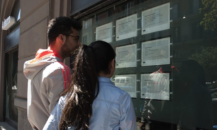 Two people look at job announcements on the window of an agency in Naples on May 3, 2012. Italy's unemployment rate hit a record of 9.8 per cent in March, as a recession in the eurozone's third-biggest economy deepens. (Anna Monaco/AFP/GettyImages)