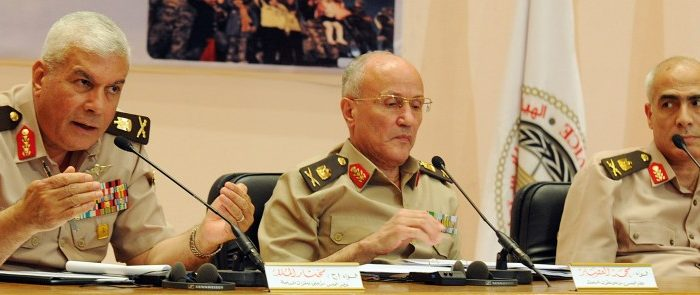 Egyptian General Mukhtar al-Mulla (L), Major General Mohammed al-Assar (C), and General Mamdouh Shahen (R), members of Supreme Council of the Armed Forces (SCAF), hold a press conference in Cairo on May 3, 2012 (AFP/GettyImages)