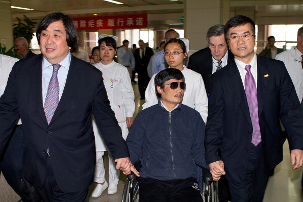Chinese dissident Chen Guangcheng holds hands with U.S. Ambassador to China Gary Locke May 2, 2012 in Beijing, China. (U.S. Embassy Beijing Press via Getty Images)