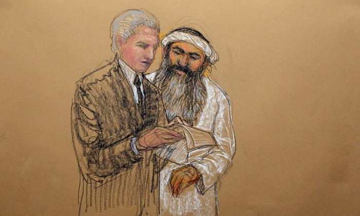In this courtroom drawing, self-proclaimed 9/11 mastermind Khalid Sheik Mohammed consults defense attorney during a break at a military tribunal on Saturday at the U.S. Naval Base in Guantanamo Bay, Cuba. (Janet Hamlin/AFP/GettyImages)
