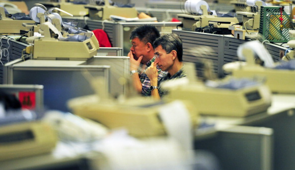 Traders work on the floor of the Hong Kong stock exchange on May 7, 2012. (Laurent Fievet/AFP/Getty Images)