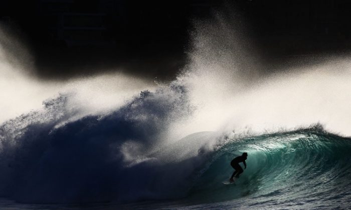 A surfer rides a wave while surfing at Bronte Beach on May 8, in Sydney, Australia. (Ryan Pierse/Getty Images)