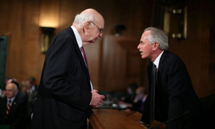 "Former Federal Reserve Board Chairman, Paul Volcker (L) talks with U.S. Sen. Bob Corker (R-Tenn.) (R) prior to a hearing before the Financial Institutions and Consumer Protection Subcommittee of the Senate Banking, Housing, and Urban Affairs Committee, May 9 on Capitol Hill in Washington, D.C. The hearing was to examine ""Is Simpler Better? Limiting Federal Support for Financial Institutions."" (Alex Wong/Getty Images)"