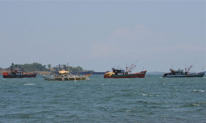 Fishing boats, locally known as 'mother boats' which are used to transport fish caught around Scarborough shoal, north of Manila, facing the South China Sea, on May 10, 2012. For years Filipino and Chinese fishermen peacefully shared the rich harvests around a tiny South China Sea shoal, but today threats, harassment and fear have replaced ocean comradery. (Ted Aljibe/AFP/Getty Images)