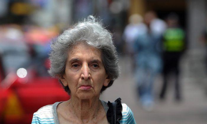 An elderly woman walks in San Jose on May 12. (RODRIGO ARANGUA/AFP/GettyImages)