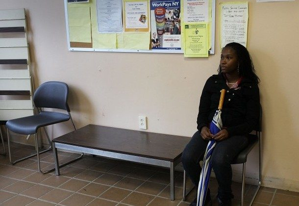 Shandola Williams waits in an employment office on May 14, in Utica, New York. Like many upstate New York communities, Utica is struggling to make the transition from a former manufacturing hub. (Spencer Platt/Getty Images)