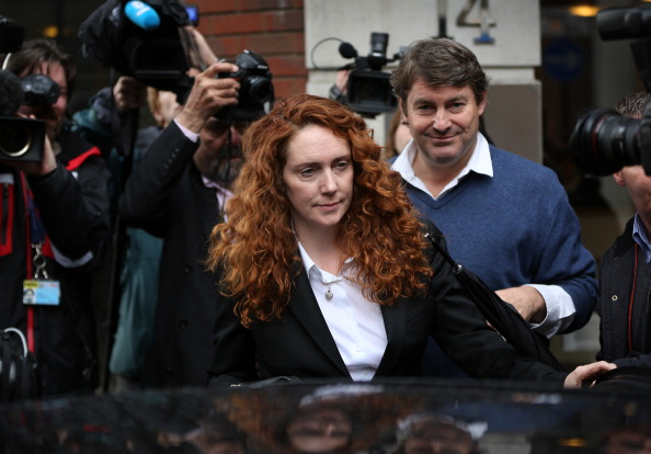 Rebekah Brooks (R) former Chief Executive of News International and Rupert Murdoch Chairman of News Corporation in London on July 10, 2011. A small experimental theatre in London has beaten Hollywood to produce the first artistic interpretation of the explosive News of the World hacking scandal using the hacked voicemails of volunteers. (Max Nash/AFP/Getty Images)