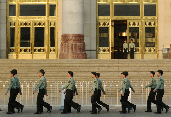 Chinese military policemen march past the Great Hall of the People beside Tiananmen Square in Beijing on May 16. (Mark Ralston/AFP/Getty Images)