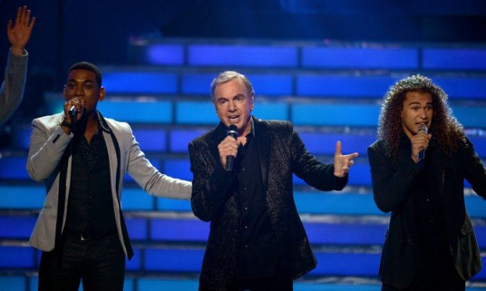 "Singers Joshua Ledet (L), Neil Diamond (C), and DeAndre Brackensick perform onstage during ""American Idol 2012"" results show at Nokia Theatre L.A. Live on May 23 in Los Angeles (Mark Davis/Getty Images)"