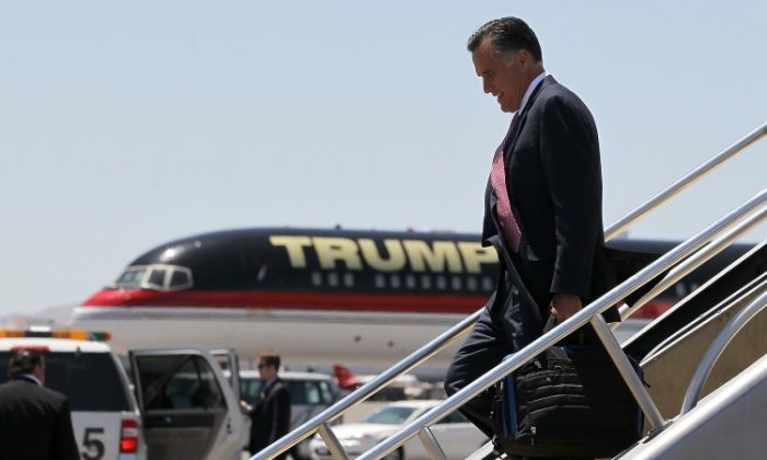 Republican presidential candidate, former Massachusetts Gov. Mitt Romney walks off of his campaign plane past Donald Trump's plane after landing at McCarran International Airport on May 29, in Las Vegas, Nevada. Mitt Romney will campaign and hold fundraisers Las Vegas, Nevada. (Justin Sullivan/Getty Images)