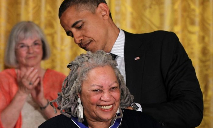 Novelist Toni Morrison is presented with a Presidential Medal of Freedom by U.S. President Barack Obama during an East Room event May 29 at the White House in Washington, D.C. The Medal of Freedom, the nation's highest civilian honor, is presented to individuals who have made especially meritorious contributions to the security or national interests of the United States, to world peace, or to cultural or other significant public or private endeavors. (Alex Wong/Getty Images)
