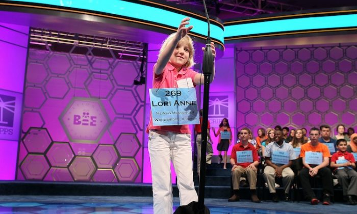 Six-year-old Lori Anne Madison reaches for the microphone during the third round of the 2012 Scripps National Spelling Bee competition May 30, 2012 in National Harbor, Maryland. 278 spellers are competing in the 85th annual competition. (Mark Wilson/Getty Images)