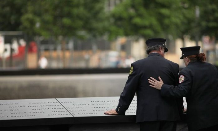 Ten years after the formal end to the Ground Zero cleanup efforts, workers pay tribute to the thousands of men and women who sacrificed their lives and their health to contain and clean up the debris left by the 9/11 attacks. (Spencer Platt/Getty Images)