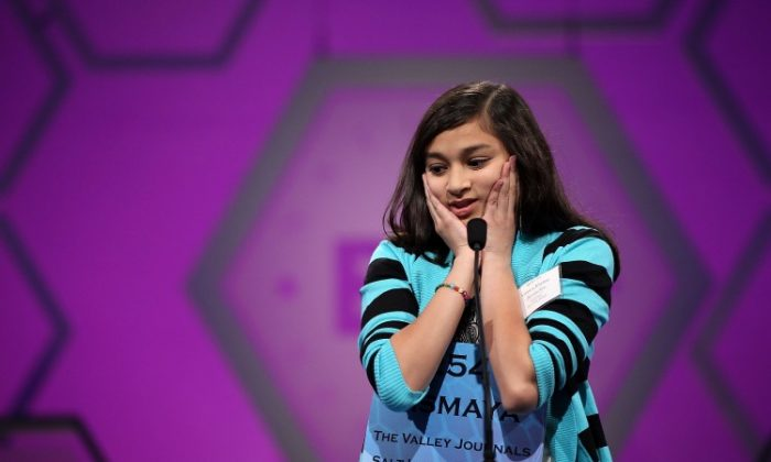 Spelling bee contestant Vismaya Jui Kharkar of Bountiful, Utah, tries to spell her word during round six of the 84th annual Scripps National Spelling Bee competition May 31 at the Gaylord National Resort and Convention Center in National Harbor, Md. (Alex Wong/Getty Images)