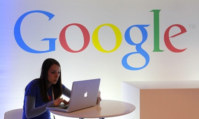 A Google employee works on a laptop before the start of a new conference about Google Maps on June 6, 2012 in San Francisco, California. (Justin Sullivan/Getty Images)
