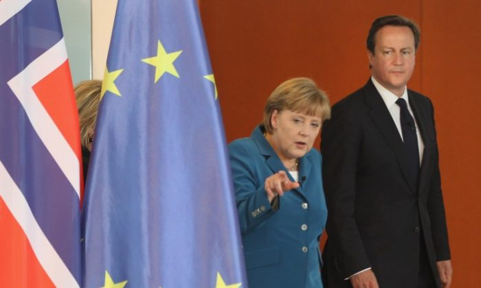 German Chancellor Angela Merkel and British Prime Minister David Cameron (R) are seen at a meeting in Berlin on June 7. Merkel has presented a eurozone banking union as one option of alleviating the ongoing euro crisis. (Sean Gallup/Getty Images)