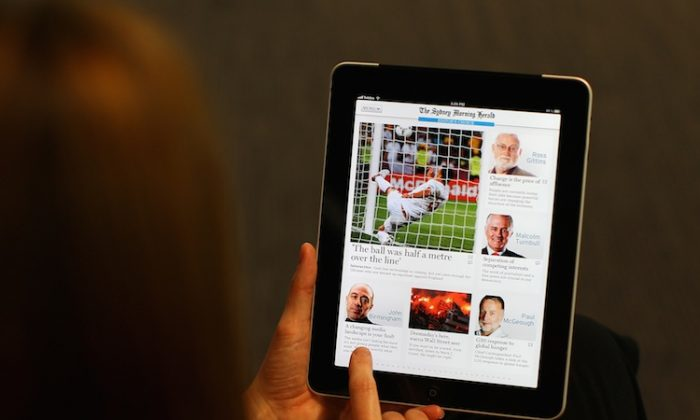 Picture of iPad user reading The Sydney Morning Herald on June 20, 2012 in Sydney, Australia. (Cameron Spencer/Getty Images)