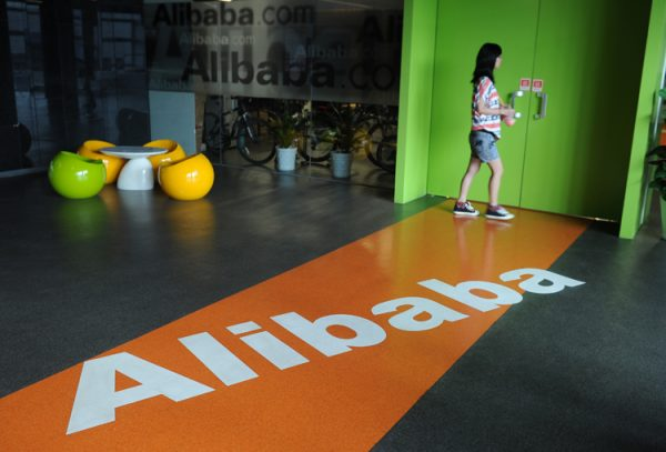 An Alibaba employee walks through a room at the company headquarters in Hangzhou, China, on June 20.