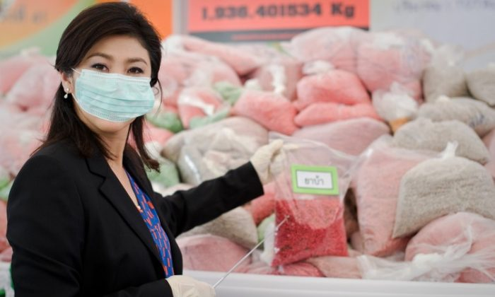 Thailand's Prime Minister Yingluck Shinawatra stands in front of bags of methamphetamine tablets in June 29, 2012. (Nicolas Asfouri/AFP/GettyImages)