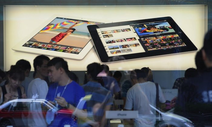 Customers flock to an Apple store where the latest version of the Apple iPad went on sale in Apple stores in Shanghai on July 20, 2012. (Peter Parks/AFP/Getty Images)