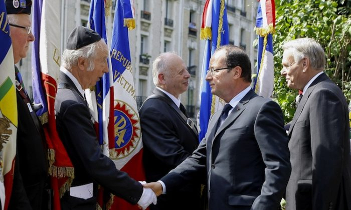 """French Interior Minister Manuel Valls (L) unveils a plaque dedicated to the """"Righteous among the Nations"""" (""""Justes parmi les nations"""" in French) for their efforts to save Jews from the Nazis during World War II, on July 22, 2012 in the center of Strasbourg, eastern France, as part of a ceremony to commemorate the seventieth anniversary of the Vel D'Hiv roundup (Rafle du Velodrome d'Hiver). (Patrick Hertzog/AFP/Getty Images)"""