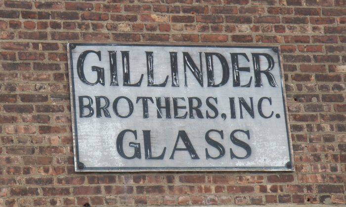 The sign on the front of Gillinder Glass Store and Factory in Port Jervis on July 15, 2015. (Holly Kellum/Epoch Times)