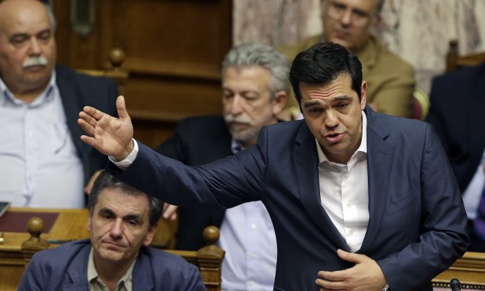 Greece's Prime Minister Alexis Tsipras delivers a speech during a parliament meeting in Athens, Thursday, July 16, 2015. (AP Photo/Thanassis Stavrakis)