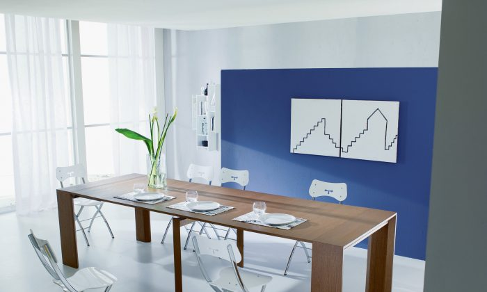 A console table folds out into a dining table. (Resource Furniture)