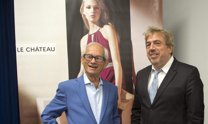 Le Chateau founder and director Herschel Segal (L) chats with Franco Rocchi, senior vice-president of sales and operations, after the company's annual meeting in Montreal on July 15, 2015. (The Canadian Press/Ryan Remiorz)