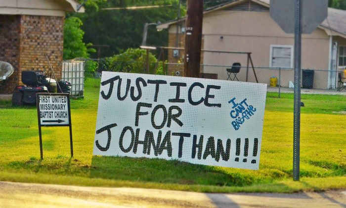 In this July 11, 2015 photograph, sign of support for Jonathan Sanders, a black man who is believed to have died after a physical encounter with a white police officer, hangs on a corner in Stonewall, Miss. (Jennifer Bozeman/The Clarke County Tribune, via AP)