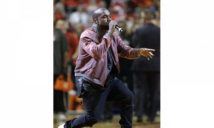 Rapper Kanye West performs during Game 4 in a second-round NBA basketball playoff series between the Cleveland Cavaliers and the Chicago Bulls in Chicago on May 10, 2015. (AP Photo/Nam Y. Huh)