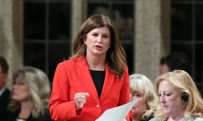 Health Minister Rona Ambrose speaks during question period in the House of Commons on June 11, 2015. Ambrose is calling on the provinces and territories to co-operate with the feds to help slash the cost of prescription drugs. (The Canadian Press/Fred Chartrand)