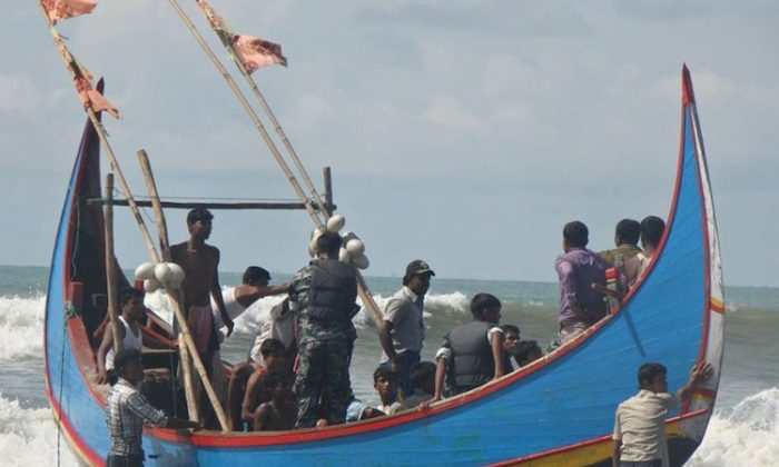 Rohingya refugees, who survived after their overloaded boat heading to Malaysia sank, are pictured on a fishing boat following their rescue by Bangladeshi border guards in Teknaf on Nov. 7. (STR/AFP/Getty Images)