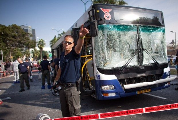 A bus targeted by a terrorist attack on Wednesday is seen in Tel Aviv. Ten people were injured in the attack. A ceasefire agreement that was reached between Israel and Hamas on Wednesday is set to become effective at 9pm local time. (Uriel Sinai/Getty Images)