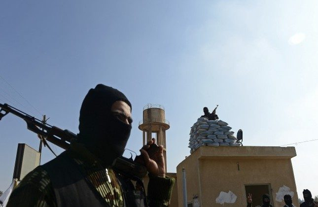 Members of a Syrian rebel group stand guard at their headquarters in al-Bab, northern Syria, on Nov. 21, 2012. (Francisco Leong/AFP/Getty Images)
