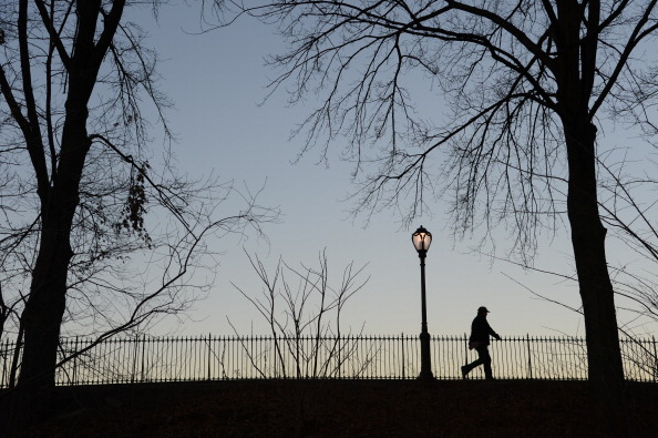 A man walks along the Reservoir after sunset on Jan. 7, 2013 in New York's Central Park. (Stan Honda/AFP/Getty Images)