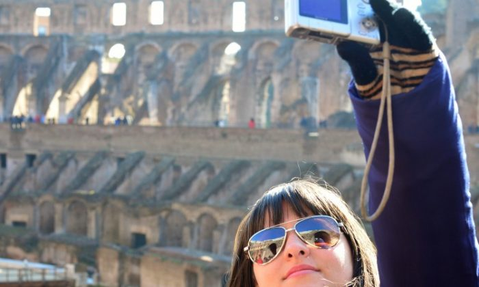 Tourists visit the Colosseum on January 18, 2013 in Rome. (Gabriel Bouys/AFP/Getty Images)