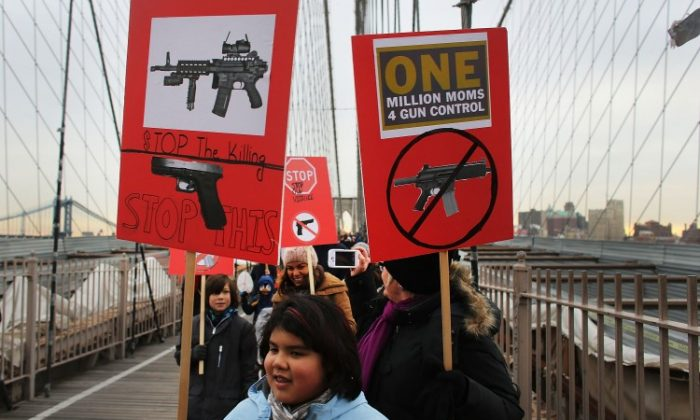 Participants with One Million Moms for Gun Control, a gun control group formed in the wake of the massacre at a Newtown, Connecticut elementary school, attend a rally and march across the Brooklyn Bridge on January 21 in New York City. (Spencer Platt/Getty Images)