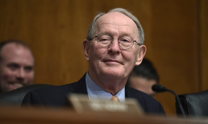 FILE - In this Jan. 21, 2015 file photo, Senate Health, Education, Labor and Pensions Committee Chairman Sen. Lamar Alexander, R-Tenn. listens to testimony on Capitol Hill in Washington.  (AP Photo/Susan Walsh, File)