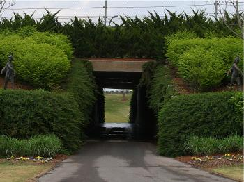 Statues, flowers, manicured bushes&#8212not common fare for race tracks. (James Fish/The Epoch Times)