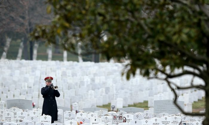 A Bugler plays 'Taps' during the funeral of Army Sergeant Aaron X. Wittman February 8, 2013 at Arlington National Cemetery in Arlington, Va. (Alex Wong/Getty Images)