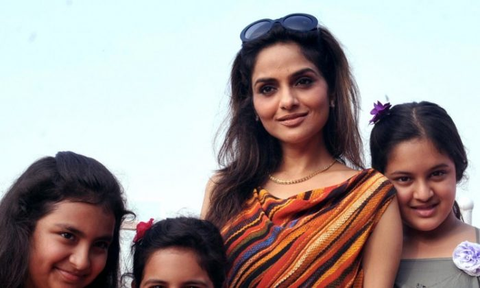 Indian Bollywood film actress Madhu Shah (2R) poses with her daughters during the 'Hello! Classic Derby Race 2013' in Mumbai on February 10, 2013. (STR/AFP/Getty Images)