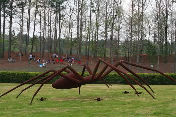 This eight-foot-tall arachnid prowls the infield with her offspring. (James Fish/The Epoch Times)