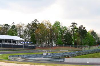 Hospitality/VIP lodgings tucked into a stand of trees overlooking the track (James Fish/The Epoch Times)