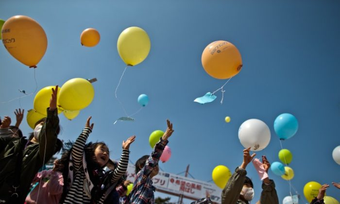 Children float balloons during the second anniversary commemoration of the earthquake and tsunami on March 10, 2013, in Minamisoma, Japan. (Athit Perawongmetha/Getty Images)