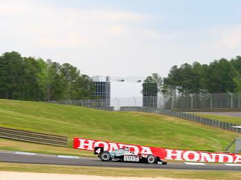 J.R. Hildebrand rounds Turn Five at Barber Motorsports Park, with the Barber Museum in the background. (James Fish/The Epoch Times)