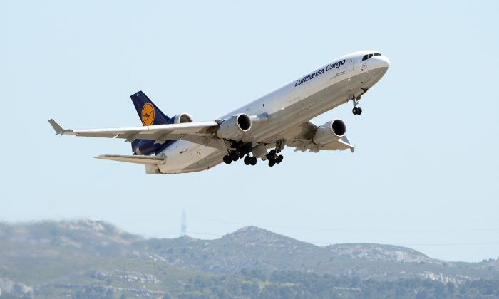 A Lufthansa cargo plane takes off from the Marseille-Provence airport in Marignane, southern France, on June 15, 2015  to rapatriate to Spain 32 coffins, victims of the Germanwings flight crash victims. 150 people died on March 24 when a Germanwings flight was deliberately crashed into the French Alps. (Boris Horvat/AFP/Getty Images)
