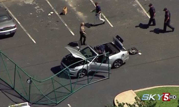 In this aerial image taken from video, law enforcement personnel work the scene of a shooting at the Navy Operational Support Center and Marine Corps Reserve Center Chattanooga Thursday, July 17, 2015, in Chattanooga, Tenn. (WTVF via AP)