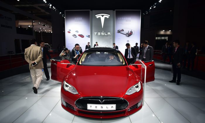 A Tesla Model S P85d car is displayed at the 16th Shanghai International Automobile Industry Exhibition in Shanghai on April 20, 2015. (Johannes Eisele/AFP/Getty Images)